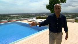 George Alagiah on rooftop pool terrace in Accra