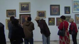 People looking at the Song for Sekoto exhibition in Johannesburg