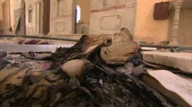 Burned book inside St. Elias church, Qusair, Syria