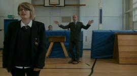 Teacher dancing behind Year 11 pupil