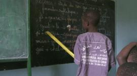 Child at a blackboard at a US-funded school in Senegal