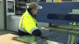 Worker in Australian sheet metal factory