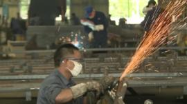 Worker in Chinese metal factory