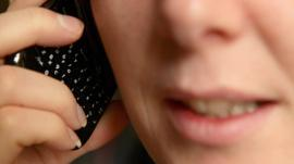A woman talking on a mobile phone