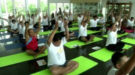 Thai policemen try to lose weight in a fitness boot camp.