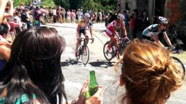 Fans cheer on riders in the Tour de France as they pass through Mijanes in the French Pyrenees