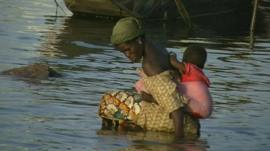 A Malian woman carrying her child