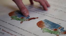 Hand on map of US dialect