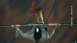 Just having a lie-down! Check out this tightrope walker's brave skills