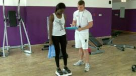 Woman on scales in gym