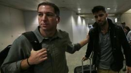 US journalist Glenn Greenwald with his partner David Miranda in Rio de Janeiro's International Airport
