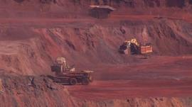 A red and brown rocky terrain being mined for metal