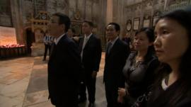 Chinese businessmen and women in Gloucester Cathedral