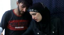 Distressed parents in an amateur picture, following an alleged chemical attack in Syria