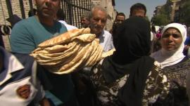People in Damascus queue for bread