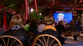 Voters watching the debate in a bar