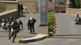 Gun battle outside the Westgate Mall, an upscale shopping mall in Nairobi, Kenya Saturday Sept. 21 2013