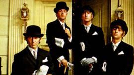 Photo of the Beatles posing as City financiers in 1964