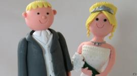 Bride and groom on a wedding cake
