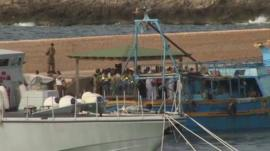 Emergency workers gathered at Lampedusa