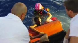 Coastguard officials pulling people to safety
