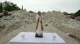 An altar in front of rubble
