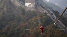 Tightrope walker above the Great Wall of China