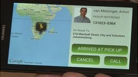 The app shows that the taxi has arrived at the pick up address