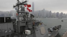 U.S. sailors of the USS Antietam (CG-54) from the George Washington Battle Group stand on the deck before sailing to the Philippines at Hong Kong Victoria Harbor Tuesday, Nov. 12, 2013
