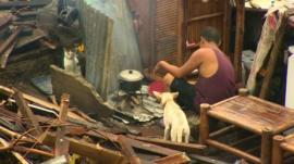 Tacloban survivor cooking