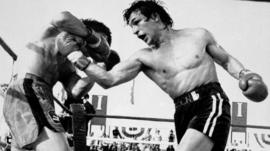 Ray 'Boom Boom' Mancini throws a punch in a bout with Deuk-Koo Kim in a 1982 title fight in which Kim later died