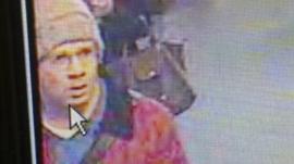 Police handout shows a suspected gunman walking in an underground station in Paris