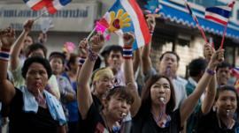 Anti-government protesters wave Thai national flags in Bangkok