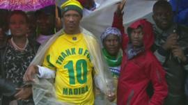Man wearing football shirt emblazoned with
