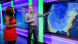 Simon King explains the weather to Ayshah Tull