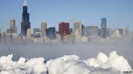 The Chicago skyline is seen beyond the arctic sea smoke rising off Lake Michigan in Chicago