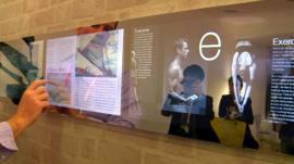 A touchscreen wall mirror