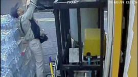 CCTV of man throwing object