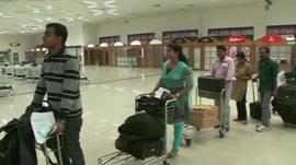 Indians in airport queue