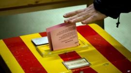 A Swiss voter casts his vote leaves at a makeshift polling station
