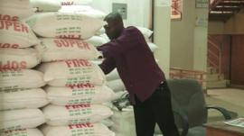 Man looks at bags of flour