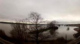 View of flooded fields from train window
