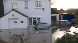 Flooded homes and submerged cars