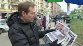 Richard Galpin looking at newspapers