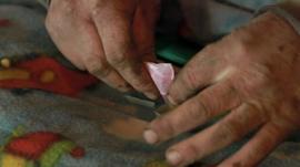 Man cooking heroin