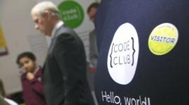 Code Club logo and Prince Andrew in the background
