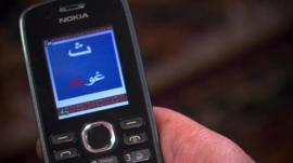 A mobile phone running software to teach literacy