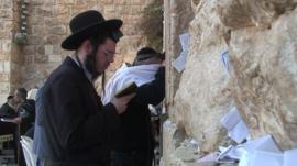 Jewish man in prayer at the Western Wall