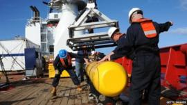 Bluefin 21 being hoisted back aboard the Ocean Shield (US Navy handout image received 10 April 2014)