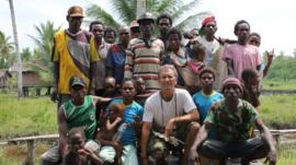 Carl Hoffman in Papua with Asmat tribe